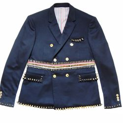 """<b>Thom Browne</b> re-constructed safety pin double breasted sportcoat with spikes in navy, <a href=""""http://www.thombrowne.com/"""">$8,915</a> at Thom Browne New York, 100 Hudson Street, NY, NY"""