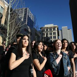 Shoppers participate in the National Anthem as City Creek Center opens in Salt Lake City, Thursday, March 22, 2012.