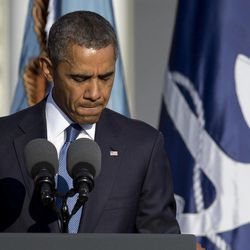 President Barack Obama pauses as he speaks during a memorial service for the victims of the Washington Navy Yard shooting at Marine Barracks Washington, Sunday, Sept. 22, 2013, in Washington.