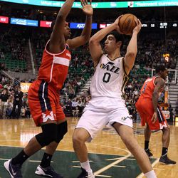 The Washington Wizards' Kevin Seraphin guards the Utah Jazz's Enes Kanter during a basketball game at the EnergySolutions Arena in Salt Lake City on Saturday, Jan. 25, 2014. The Jazz won 104-101.