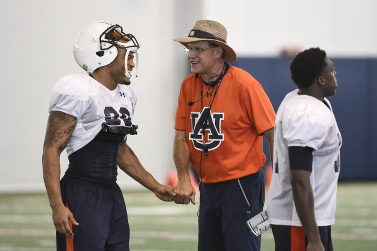 Gus Malzahn and Tray Matthews at Friday's practice