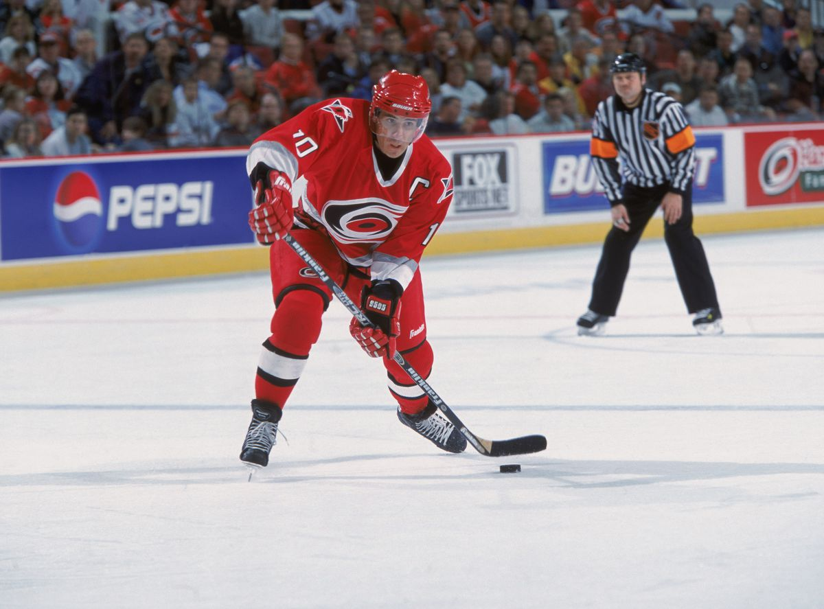 Ron Francis looks to pass the puck