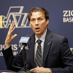 Quin Snyder looks on after being introduced as the new Utah Jazz head coach during a news conference Saturday, June 7, 2014, in Salt Lake City. The Utah Jazz announced Friday that they have hired Atlanta Hawks assistant coach Snyder to replace Tyrone Corbin, who was let go earlier this year after three-plus seasons in Salt Lake City. Snyder most recently completed his first season as an assistant with Atlanta. He has also been an assistant with the Los Angeles Lakers, the Philadelphia 76ers and the Los Angeles Clippers.  (AP Photo/Rick Bowmer)