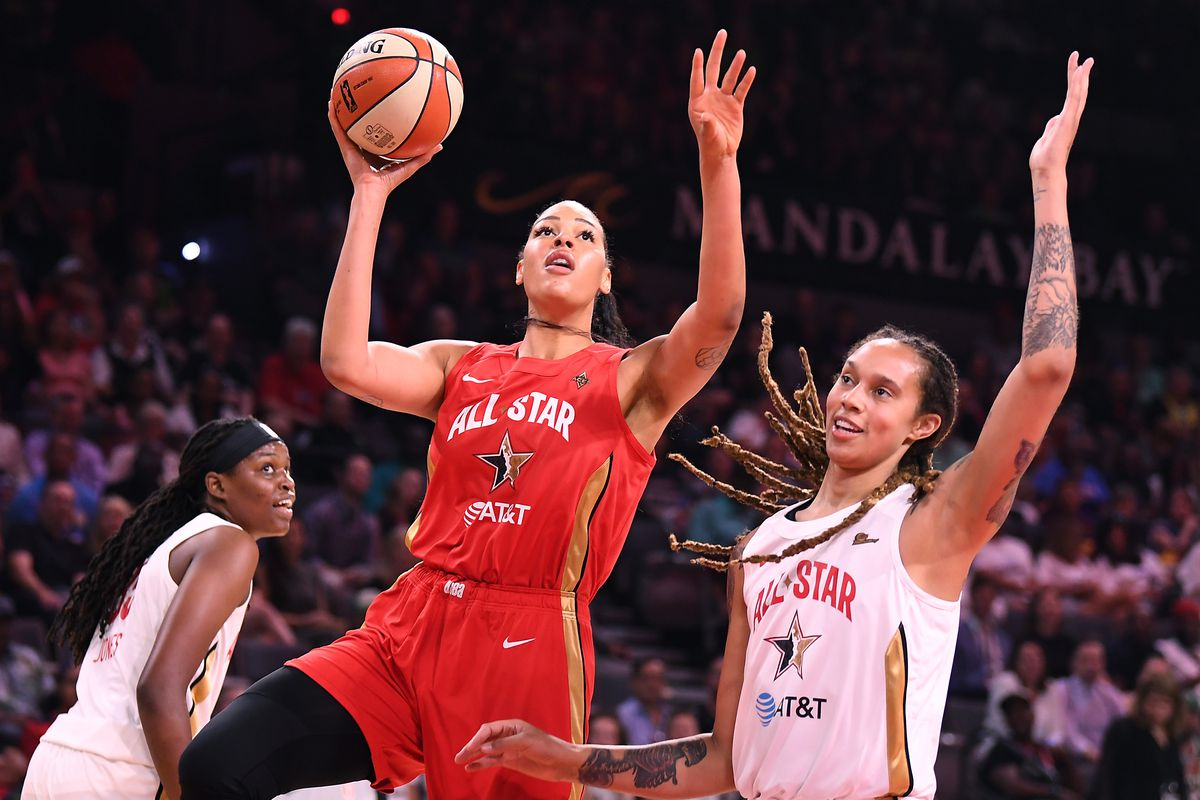 Team Wilson forward Liz Cambage shoots inside the defense of Team Delle Donne forward Brittney Griner during the first half of the WNBA All Star Game at Mandalay Bay Events Center.