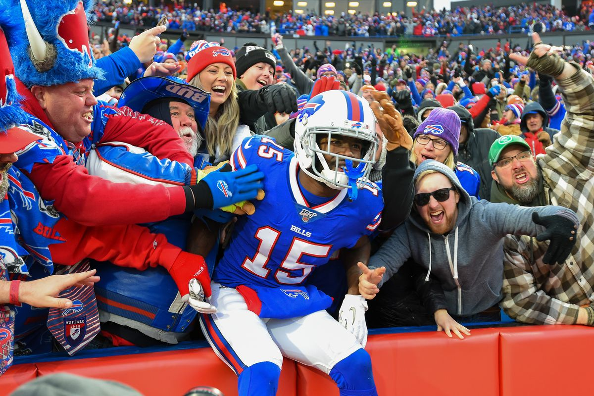 Buffalo Bills wide receiver John Brown celebrates his touchdown catch with fans against the Denver Broncos during the fourth quarter at New Era Field.