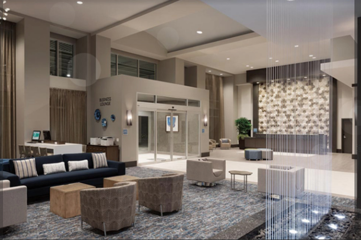 A rendering showing a high-end lobby in neutral tones.