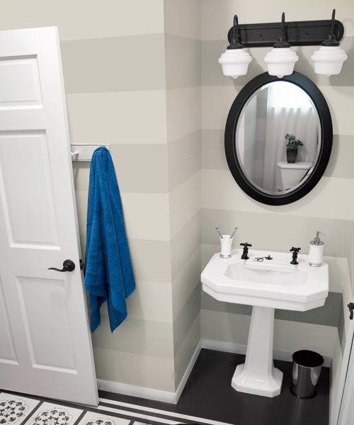Horizontal stripes wall in small bathroom.