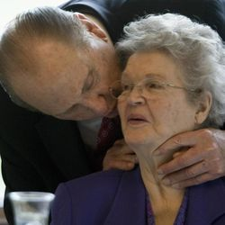 In the middle of President Thomas S. Monson's remarks at the new 8-story Zion Bank Financial Center on University Avenue he stops to give his wife Frances a kiss on the cheek. His remarks included a story about cheek kisses. Friday, May, 14, 2010.