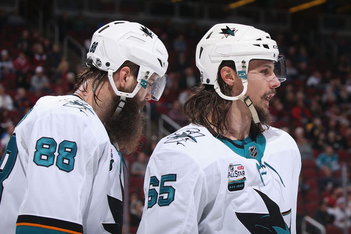 Brent Burns #88 and Erik Karlsson #65 of the San Jose Sharks during the third period of the NHL game against the Arizona Coyotes at Gila River Arena on January 16, 2019 in Glendale, Arizona. The Coyotes defeated the Sharks 6-3.