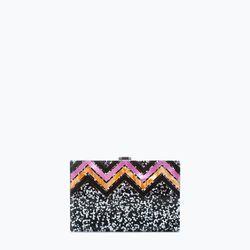 "Zara glitter box clutch, <a href=""http://www.zara.com/us/en/shoes---bags/woman/handbags/glitter-box-clutch-c665016p1983504.html"">$79.90</a>"