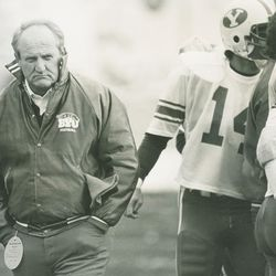 Former BYU football coach LaVell Edwards, left.