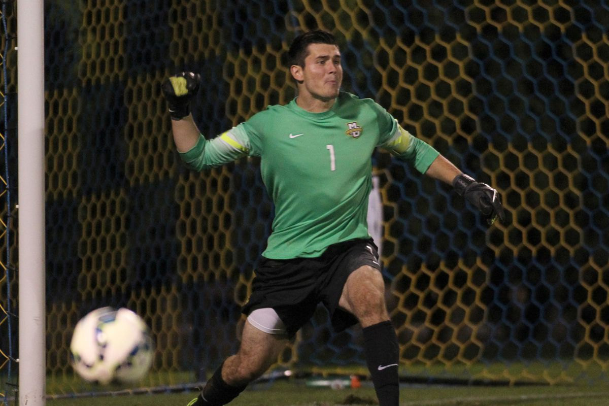 Charlie Lyon, mid-fist pump to celebrate denying UWM's Laurie Bell a penalty kick goal.