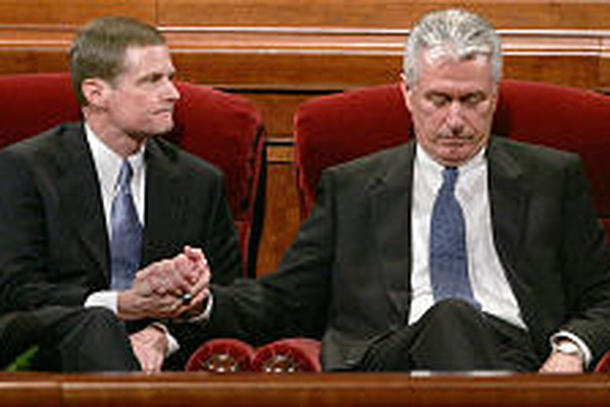 Elder David A. Bednar, left, and Elder Dieter F. Uchtdorf take their seats among the Quorum of the Twelve after they were named apostles.