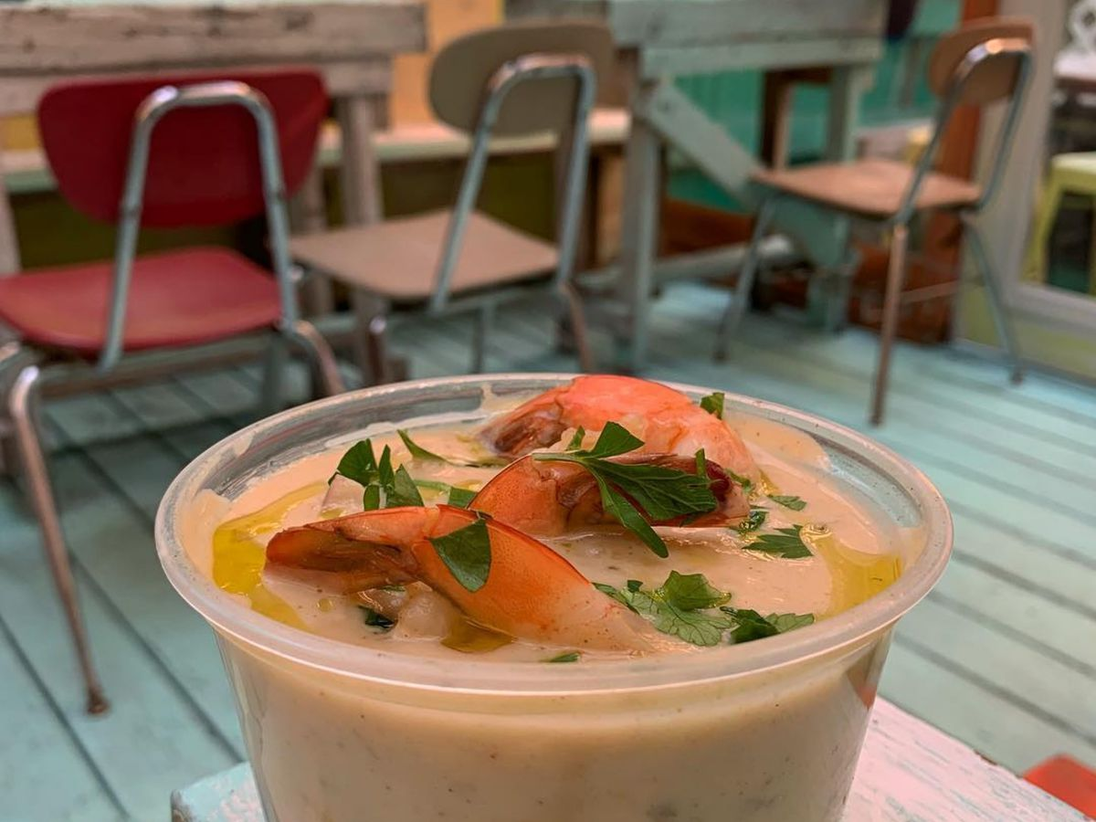 Seafood sticking out of the conch and shrimp chowder at Lolo's Seafood Shack in Harlem