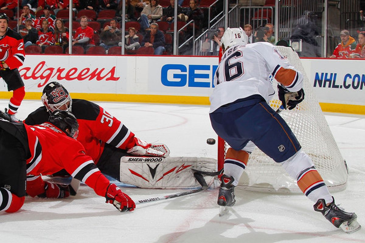 Andy Greene, you were doing it wrong here.  Martin Brodeur wished you weren't doing it wrong.  Only Colin Fraser appreciated you doing it wrong. (Photo by Paul Bereswill/Getty Images)