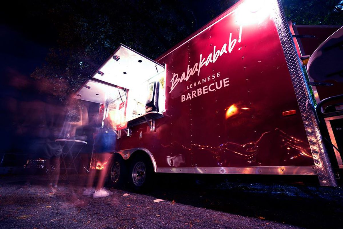 A photo of the Lebanese barbecue food truck Babakabab at night with a line of people