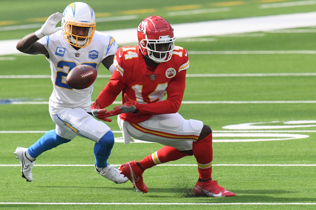 Wide receiver Sammy Watkins #14 of the Kansas City Chiefs drops a pass in front of cornerback Casey Hayward #26 of the Los Angeles Chargers during the third quarter at SoFi Stadium on September 20, 2020 in Inglewood, California.