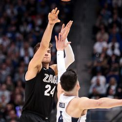 Gonzaga Bulldogs forward Corey Kispert (24) shoots over Brigham Young Cougars guard Alex Barcello (4) at the Marriott Center in Provo on Saturday, Feb. 22, 2020.