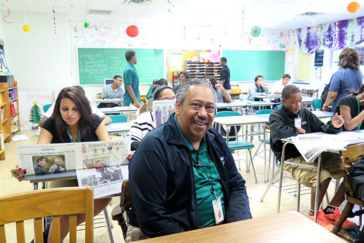 School board member Michael Brown sits in an English classroom at Northwest High School. Brown is running for reelection this fall.