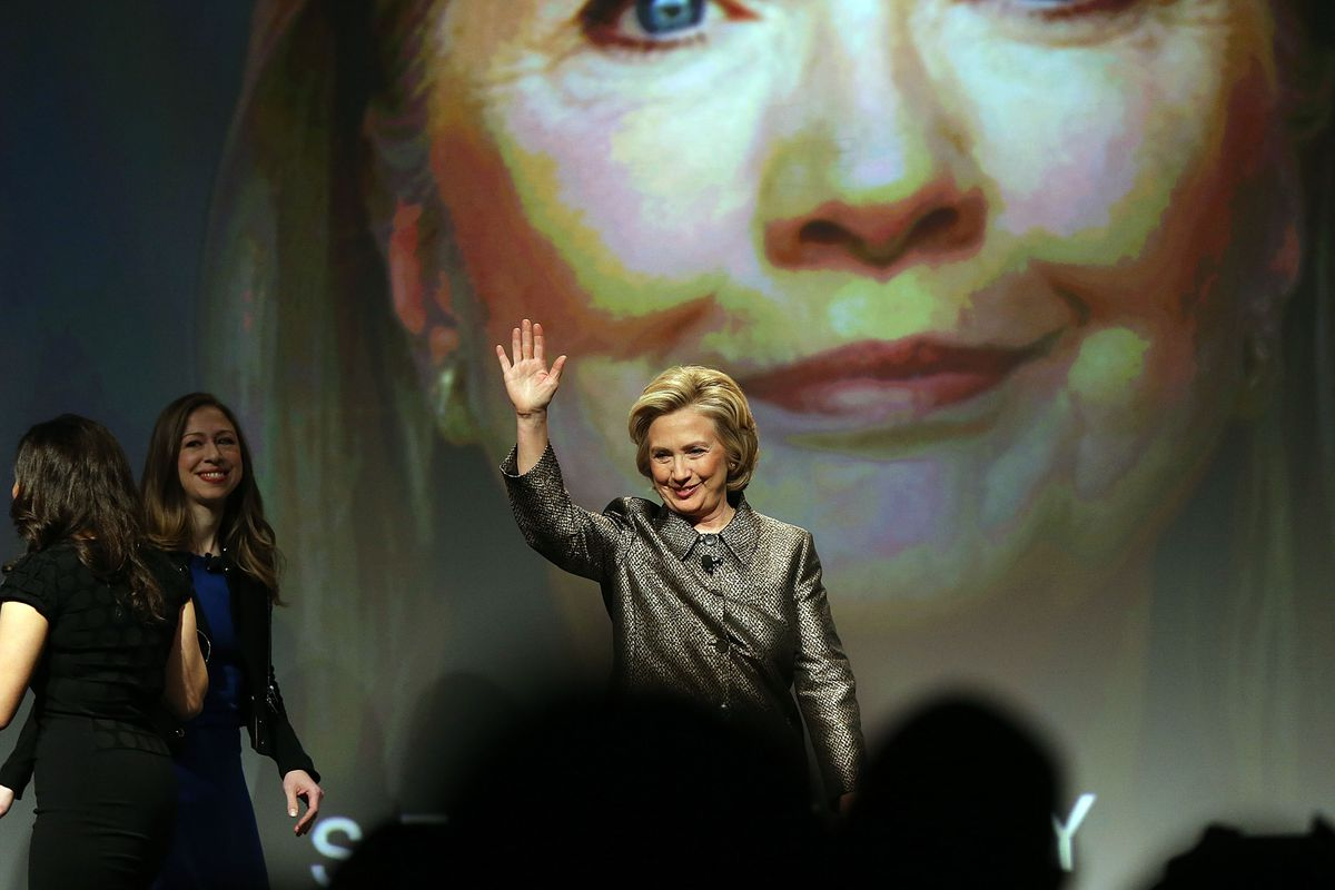 Hillary Clinton walks onstage for the release of the Clinton Foundation's No Ceilings Full Participation Report