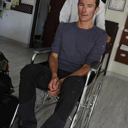 French national Armand Manel, 42, one of the survivors of an avalanche at Mount Manaslu in northern Nepal, is carried on a wheelchair at a clinic in Katmandu, Nepal, Sunday, Sept. 23, 2012. The avalanche swept away climbers on a Himalayan peak in Nepal on Sunday, leaving at least nine dead and six others missing, officials said.