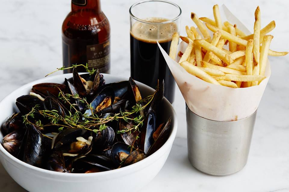 Mussels in a big bowl with frites