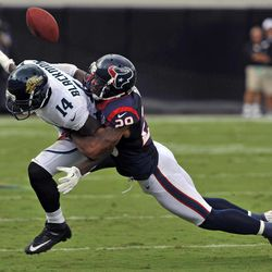 Houston Texans strong safety Glover Quin (29) breaks up a pass intended for Jacksonville Jaguars wide receiver Justin Blackmon (14) during the first half an NFL football game on Sunday, Sept. 16, 2012, in Jacksonville, Fla.