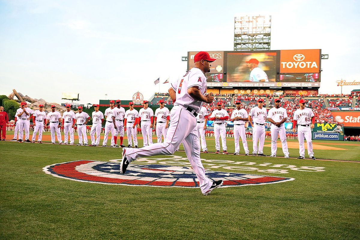 Los Angeles Angels first baseman Albert Pujols (5) is introduced before playing against the Kansas City Royals at Angel Stadium.