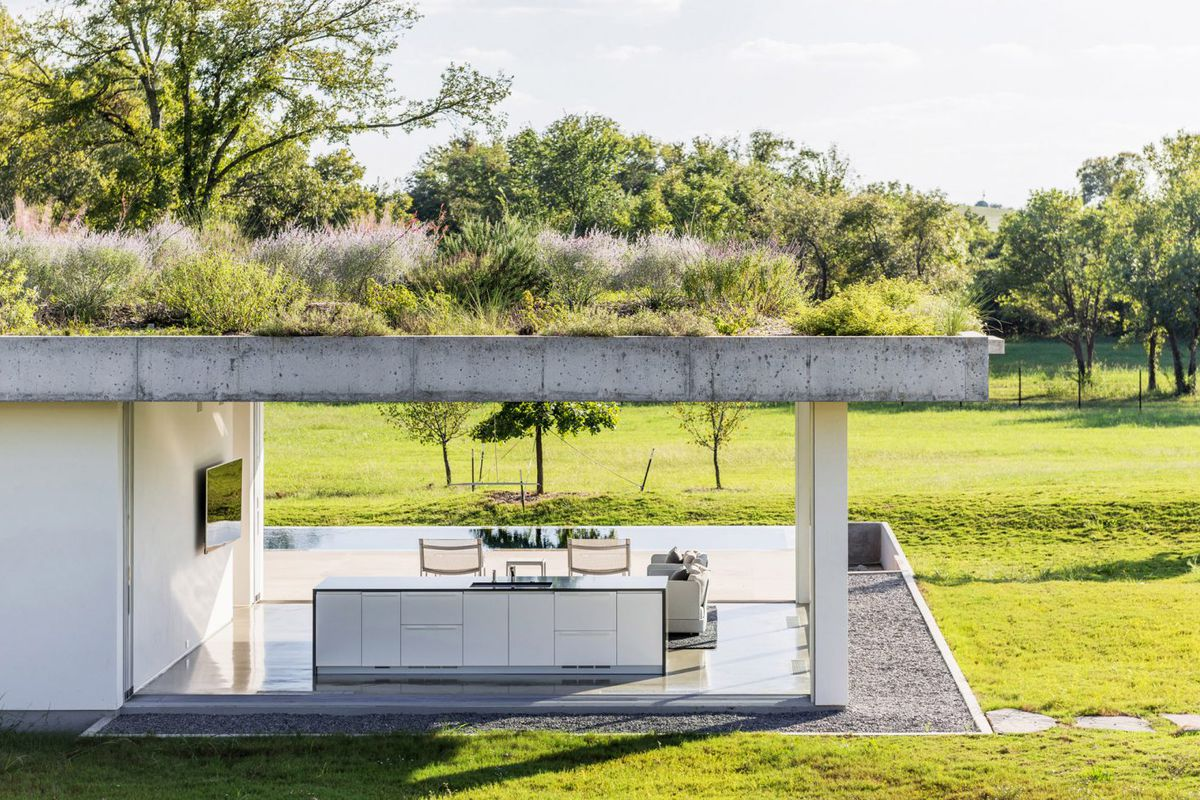 This Minimalist Pool House With Green Roof Is All About