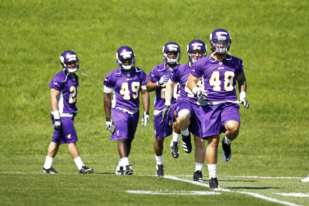 May 4, 2012; Eden Prairie, MN, USA; Minnesota Vikings fullback Matt Asiata (48) leads other Minnesota Vikings in warm up exercises at rookie camp at Winter Park. Mandatory Credit: Bruce Kluckhohn-US PRESSWIRE
