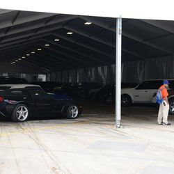 2:59 p.m. Cars in the VIP/Players parking tent -