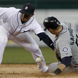 Seattle Mariners' Michael Saunders (55) steals second base as Detroit Tigers second baseman Ramon Santiago (39) can't handle the throw from catcher Alex Avilla in the third inning of a baseball game in Detroit, Wednesday, April 25, 2012.