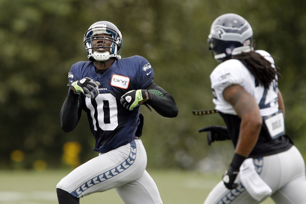 Aug 8, 2012; Renton, WA, USA; NFL: Seattle Seahawks wide receiver Terrell Owens (10) looks up to catch a pass during training camp practice at the Virginia Mason Athletic Center. Mandatory Credit: Joe Nicholson-US PRESSWIRE