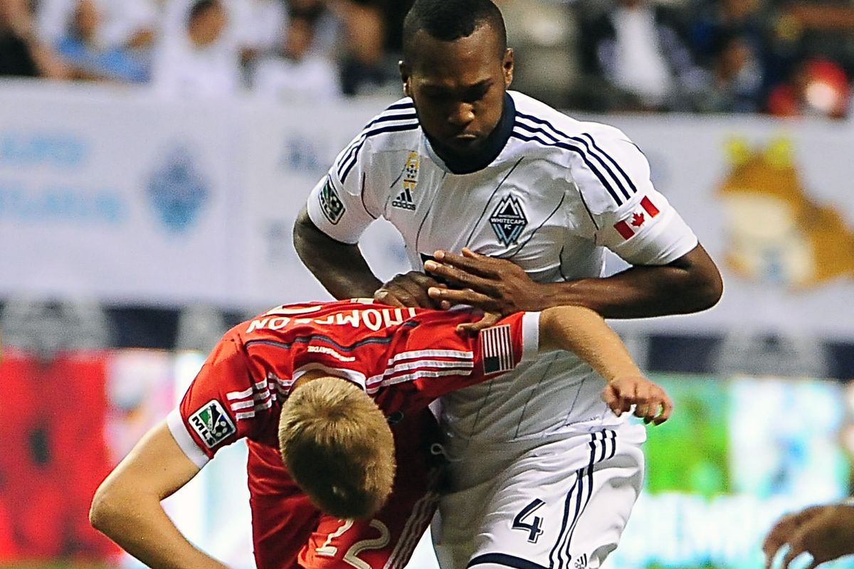 The Beast of the Backline, Vancouver Whitecaps CB Kendall Waston (#4) keeps SJE forward Tommy Thompson under control.