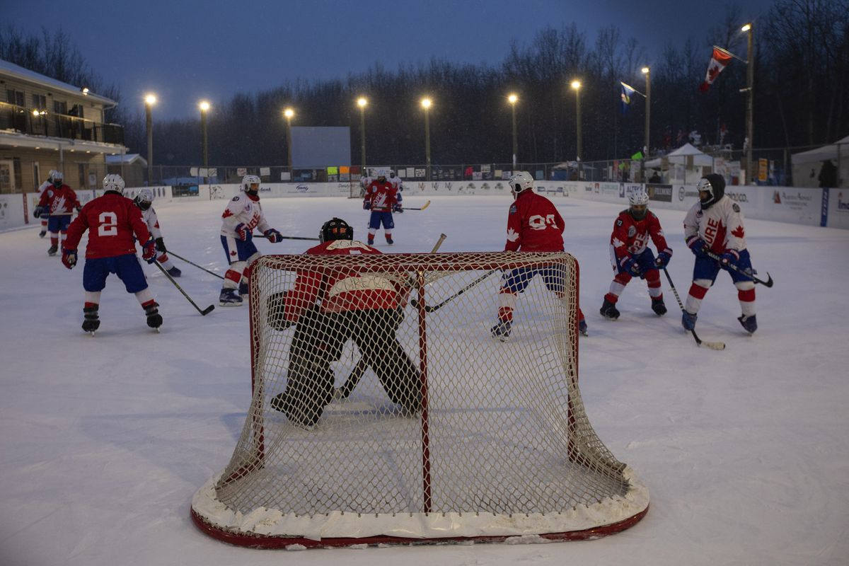 Players take part in the World's Longest Hockey Game near Edmonton on Feb. 11. Forty players took part in the game that lasted 252 hours, to raise money for cancer research.