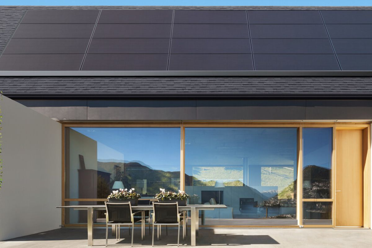 Rendering of Tesla solar panels on a modern house.