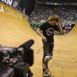 Shaun White reacts to falling in the vert final at Energy Solutions Arena for the Salt Lake City stop of the Dew Tour on Saturday, Sept. 10, 2011.