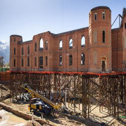 To enable excavation for basement of new Provo City Center Temple, exterior walls elevated on scaffolding and seemed for a while to be hovering in the air.