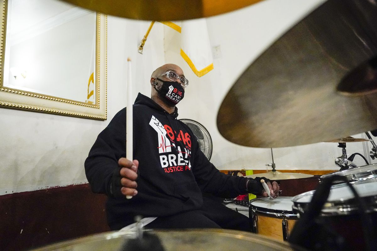 Terrence Floyd, brother of George Floyd, plays the drums with other artists during a December 2020 New York recording session for an album of protest songs.