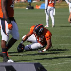 Colorado native, University of Wyoming alumni, and now rookie Denver Broncos OLB Eddie Yarbrough dives on a ball during loose ball drills.