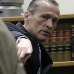 Martin MacNeill speaks to attorneys in his murder trial in Provo's 4th District Court on Friday, Nov. 8, 2013. MacNeill is charged with murder in the 2007 death of his wife, Michele MacNeill.