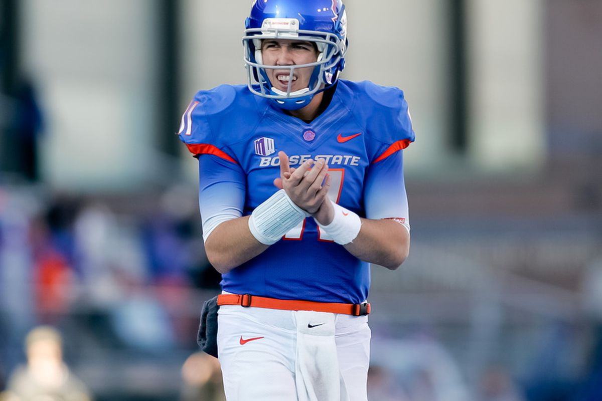 BOISE, ID - NOVEMBER 26: Kellen Moore #11 of the Boise State Broncos applauds a touchdown against the Wyoming Cowboys at Bronco Stadium on November 26, 2011 in Boise, Idaho.  (Photo by Otto Kitsinger III/Getty Images)