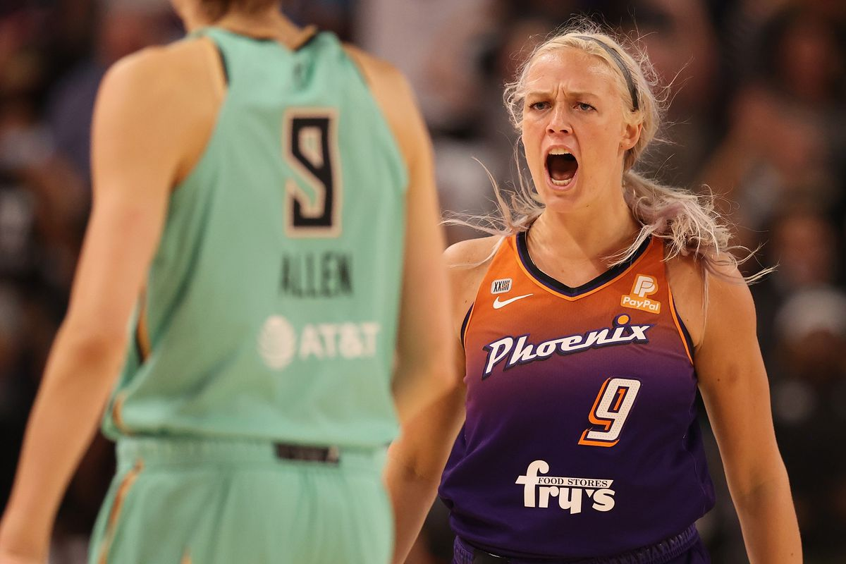 Sophie Cunningham #9 of the Phoenix Mercury reacts after hitting a three-point shot over Rebecca Allen #9 of the New York Liberty during the second half of the first round WNBA playoffs at Grand Canyon University Arena on September 23, 2021 in Phoenix, Arizona.