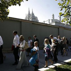 More than 100,000 Church members, friends and invited guests wakl past Temple Square after the morning session of the182nd Semiannual General Conference for The Church of Jesus Christ of Latter-day Saints in the Conference Center in Salt Lake City on Saturday, Oct. 6, 2012.