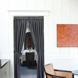 A glimpse into the dining room from the lounge, art work is by Jonah Ward, whose work is currently displayed at 12 Gallagher Lane in SF.