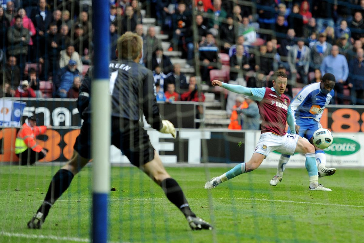You won't save this one Green. As N'Zogbia scores the third for Latics to win 3-2 against West Ham in 2010.