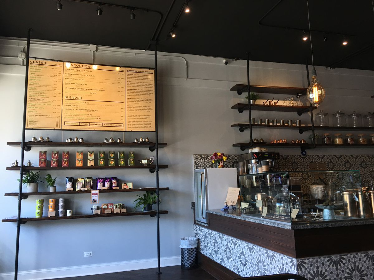 A minimalistic coffee shop with painted tiles decorating the brew bar.