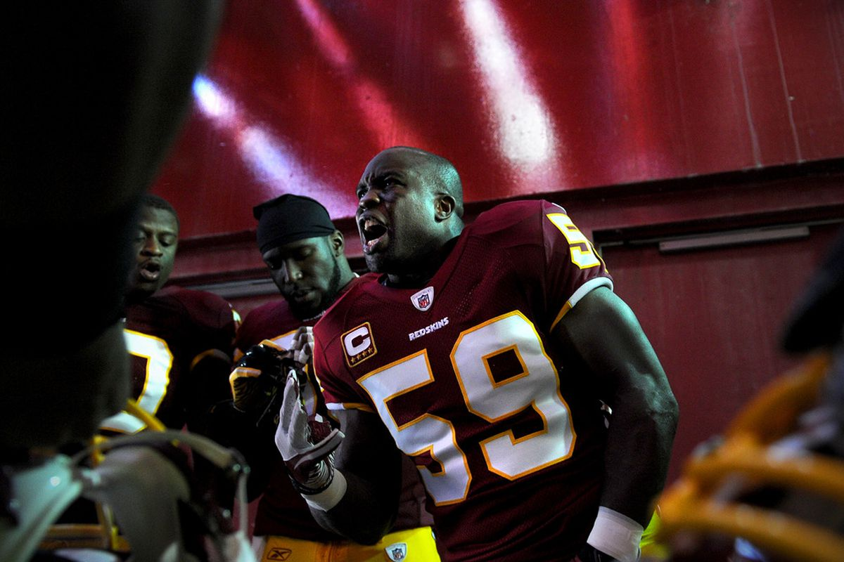 LANDOVER, MD - NOVEMBER 6: Linebacker London Fletcher #59 of the Washington Redskins pumps up other linebackers before taking on the San Francisco 49ers at FedExField on November 6, 2011 in Landover, Maryland. (Photo by Patrick Smith/Getty Images)