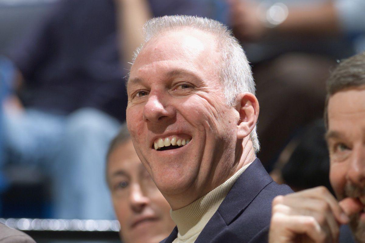 Coach Gregg Popovich smiles
