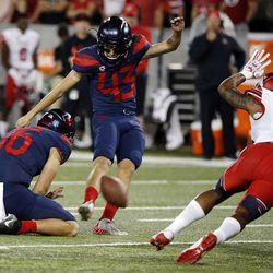 Arizona Wildcats place-kicker Lucas Havrisik has his field-goal attempt blocked by Utah Utes defensive tackle Lowell Lotulelei in Tucson, Arizona, on Friday, Sept. 22, 2017. Utah beat Arizona 30-24.